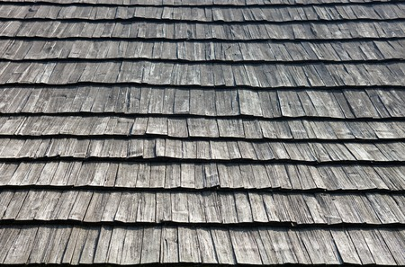 shingle: Old wooden shingle roof. Wooden surface texture.