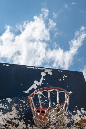 nike: KYIV, UKRAINE -  JUNE 17, 2014: Partly damaged Jumpman logo by Nike painted on the black backboard of the old basketball court in Kyiv.