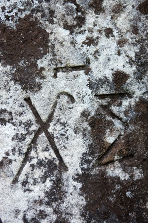 slavonic: The surface of the old cross gravestone with engraved Old Church Slavonic inscriptions. Kyiv, Ukraine. Close up. Stock Photo