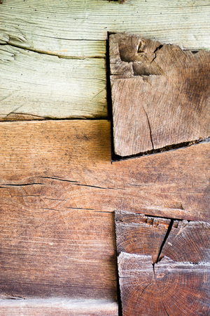 vernacular: The corner of the old log house. Close up. Wooden texture.