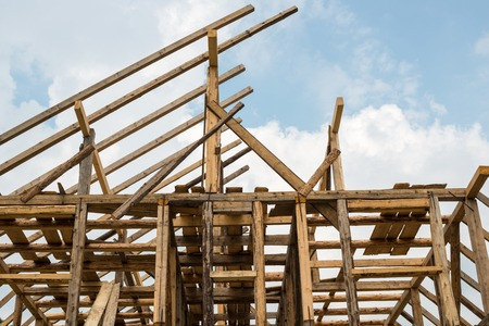 framing: Wooden framing of the new residential house. Stock Photo