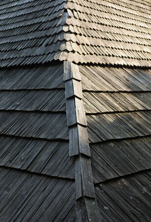 shingle: Old wooden shingle roof with rich texture.