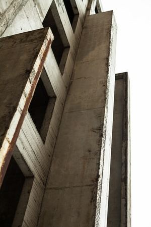 unfinished building: Concrete wall with window openings of the unfinished building
