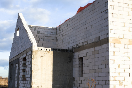 Construction of the new white brick house. photo