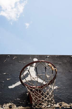 playground basketball: KYIV, UKRAINE -  JUNE 17, 2014: Jumpman logo by Nike painted on the black backboard of the old basketball court in Kyiv. Editorial