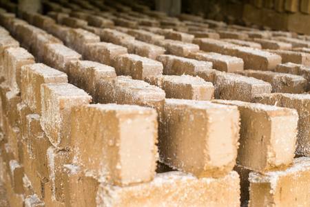 scobs: Raw bricks covered with sawdust drying in the open air.