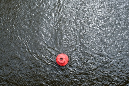 pilotage: Red round buoy on the water surface. View from above. Stock Photo