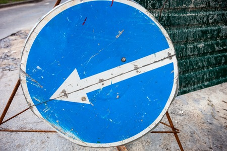 turn left sign: Turn left sign with scratched surface. Close up. Stock Photo
