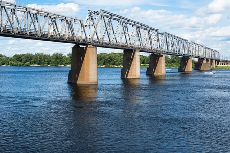 right bank: Petrivskiy railroad bridge in Kyiv (Ukraine) across the Dnieper. View from the right bank of the river.