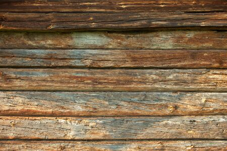 woody: The wall of the old log house. Wooden texture.