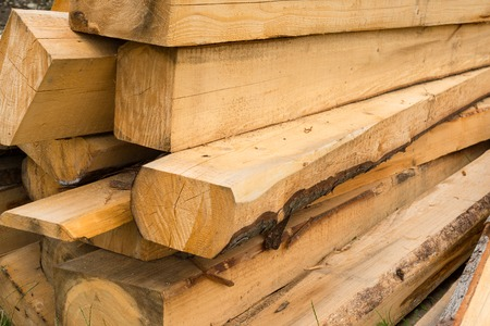 wooden beams: Pile of wooden beams in the construction site. Close up. Stock Photo