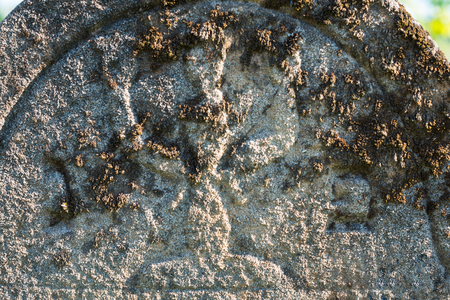 Gravestone in the old abandoned Jewish cemetery in the Ukrainian Carpathian Mountains. Close up.
