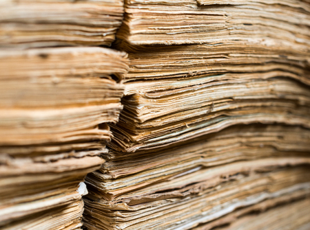 clerical: Stack of the old paper documents in the archive.