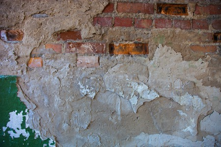plasterwork: Old brick wall with the damaged plaster. Stock Photo