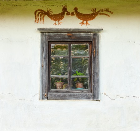 daub: Decorated window of the old traditional Ukrainian house built in wattle and daub technique.
