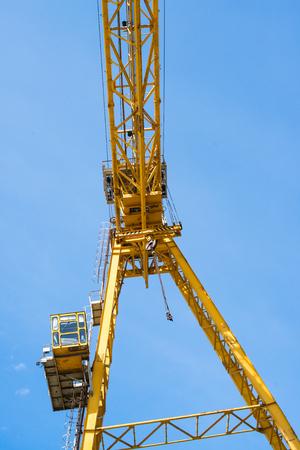 trapezoid: Gantry crane against the blue sky background