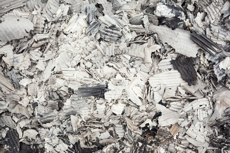 charred: Pile of burnt corrugated paper. Close up. Stock Photo
