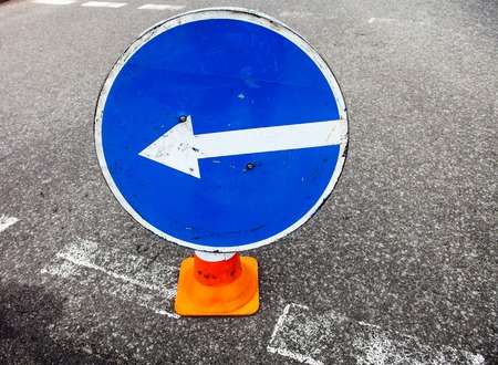 turn left: Turn left sign on the traffic cone. Close up. Stock Photo