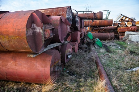 corrosion: Stack of the old abandoned rusty metal pipes.