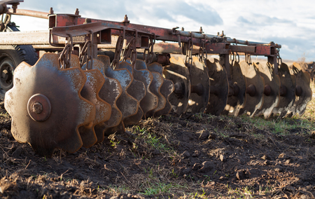 harrow: Disc harrow used to cultivate the soil. Close up.