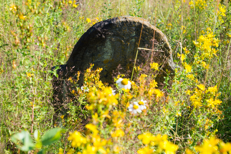 godforsaken: Gravestone in the old abandoned Jewish cemetery in the Ukrainian Carpathian Mountains.