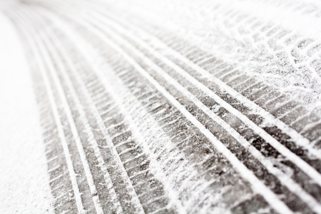 tire tread: Wheel tracks on the winter road covered with snow. Stock Photo