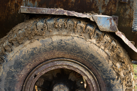 squalid: Muddy wheels of the big truck. Close up.