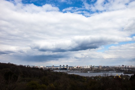 right bank: The left bank of the Dnieper river in Kyiv (view from the right bank) in early spring.
