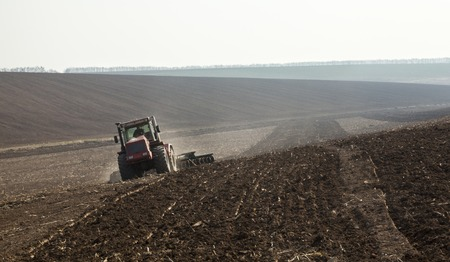 harrowing: Harrowing the soil with disc harrows in spring in Ukraine.