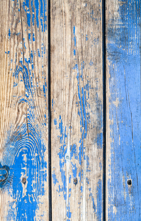 Old wooden surface with the remains of the blue paint