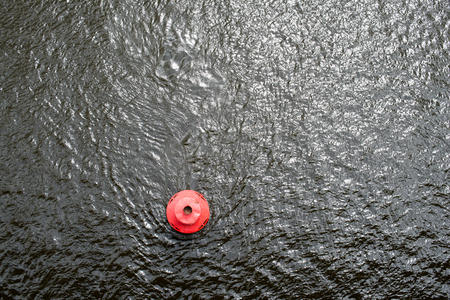 Red round buoy on the water surface. View from above. Stok Fotoğraf