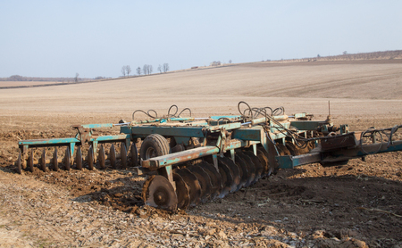 Harrowing the soil with disc harrows in spring in Ukraine. Stok Fotoğraf - 109558358