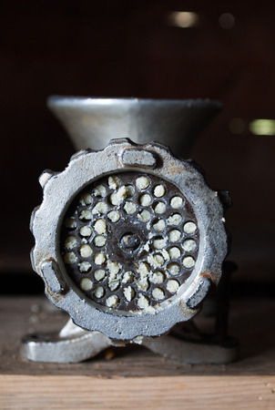 Hand-powered mincing machine (meat grinder or meat mincer). Close-up.