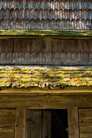Entrance to the old wooden bell tower near the church (XVIII century) in the village Huklyvy in the Ukrainian Carpathians.