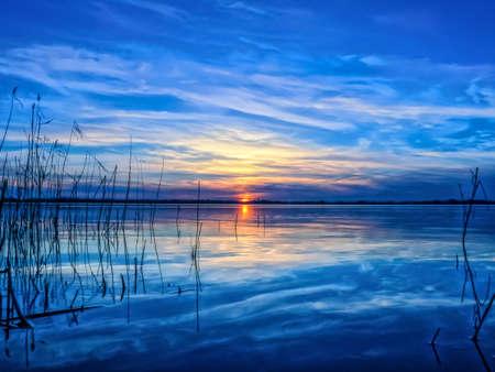 winter sunrise: Blue sunset at the lake Stock Photo
