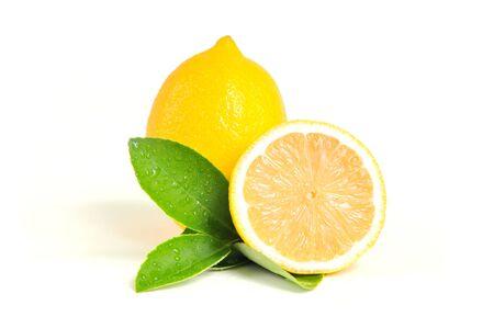 Lemon isolated on white background. Lemon fruit, vitamin C, Ripe juicy lemons, orange and green leaves on white background Stock fotó