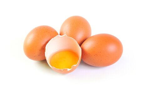 Eggs with one broken on white background