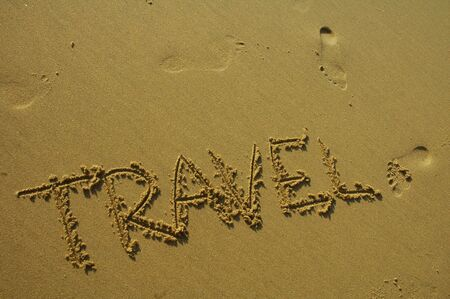 travel written in the sand Stock Photo