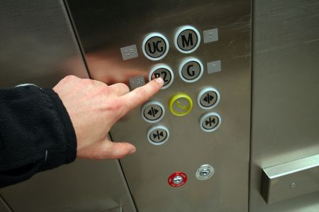 chrome man: man hand pushing B2 button in chrome elevator