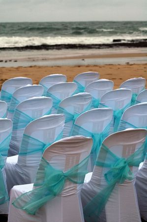 detail photo of chairs on a beach prepared for wedding Stock Photo