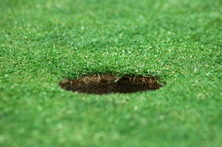 green short cutted grass, brown golf hole photo