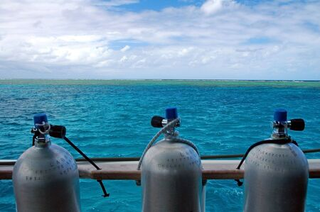 three scuba cylinders, green water, great barrier reef Stock Photo