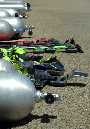 diving equipement, air cylinders, weight belts, distance blurring