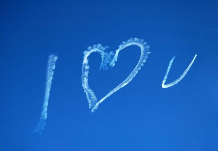blue sky, white text created with a jet: I LOVE U photo