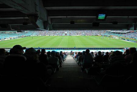soccer stadium, soccer stadium, green playfield, players, fans in shadow