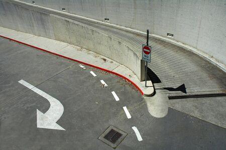 concrete and asphalt crossroad, no access sign, white arrow Stock Photo - 685648