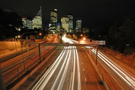 night traffic in Sydney, Sydney CBD in background, car light trails Stock Photo