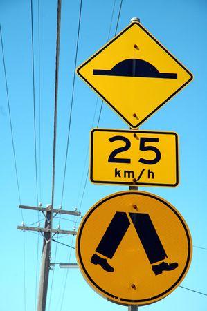 cross walk: three yellow australian signs: retarder, speed limitation, pedestrian cross walk,