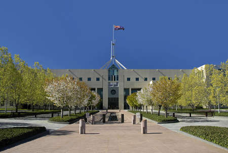 canberra: Parliament House in Australian capital city Canberra, waving flag Stock Photo