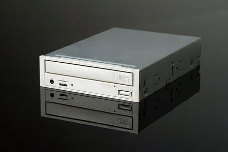 portable rom: internal CD-ROM drive on black reflective background, Stock Photo